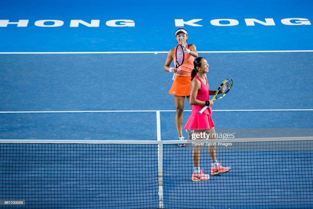 Jia-Jing Lu (bottom) of China and Qiang Wang (top) of China celebrate winning the women's doubles semi-final match against Monique Adamczak of Australia and Kai-Chen Chang of Taiwan at the Prudential Hong Kong Tennis Open 2017 at Victoria Park on October 14, 2017 in Hong Kong, Hong Kong.