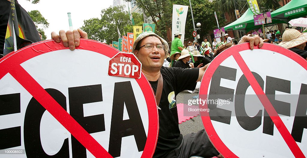 Jian Jin-de, a supporter of opposition Democratic Progressive Party (DPP), holds placards at a sit-in protest in Taipei, Taiwan, on Thursday, May 20, 2010. President Ma Ying-jeou has pushed for the trade agreement with China to prevent Taiwan from being 'marginalized' after a Chinese accord with the 10-member Association of Southeast Asian Nations took effect this year. The proposal sparked opposition demonstrations amid concern China may boost its influence over Taiwan. Photographer: Maurice Tsai/Bloomberg via Getty Images