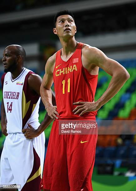 Jian lian Yi of China looks on in the men's preliminary round group A game 33 against Venezuela on Day 5 of the Rio 2016 Olympic Games at the Carioca...