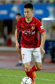 Jian Liu of Guangzhou runs with the ball during the international friendly match between FC Guangzhou Evergrande Taobao FC and FC Bayern Muenchen of...
