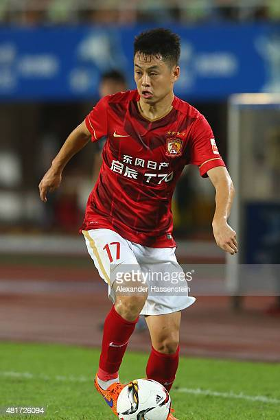 Jian Liu of Guangzhou runs with the ball during the international friendly match between FC Guangzhou Evergrande Taobao FC and FC Bayern Muenchen of...