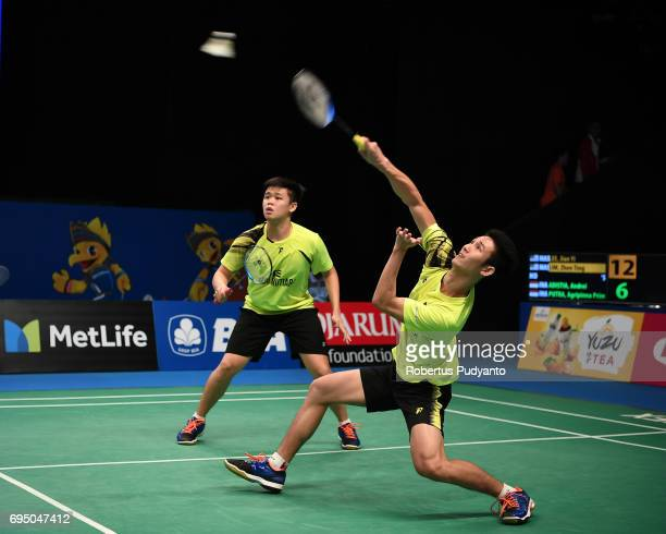 Jian Yi Lee and Zhen Ting Lim of Malaysia compete against Andrei Adistia and Agripinna Prima Rahmanto Putra of Indonesia during their qualification...