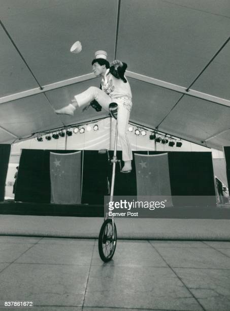 Jiang Feng performs a balancing act atop a 7foot unicycle He places bowls on his right 2 foot as he pedals with his left and flips the bowls onto the...