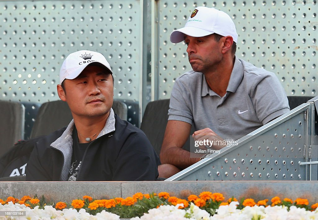 Jiang Shan and Carlos Rodriguez coach of Li Na of China in her match against Madison Keys of USA during day two of the Mutua Madrid Open tennis...