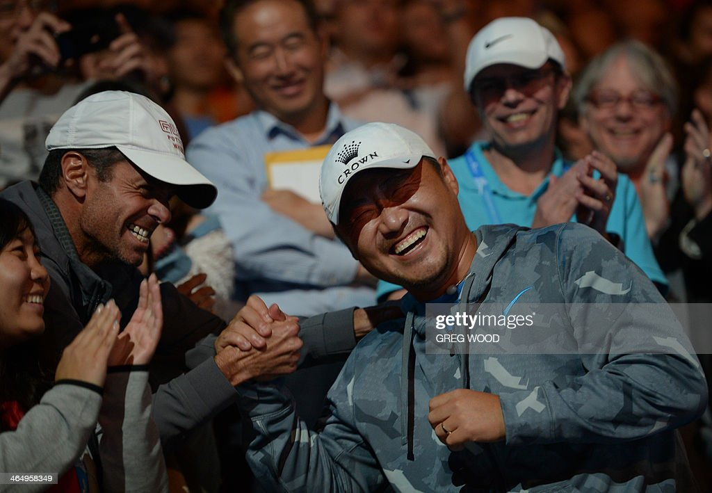 Jiang Shan the husband of China's Li Na celebrates with Na's coach Carlos Rodriguez after her victory in the women's singles final match against...