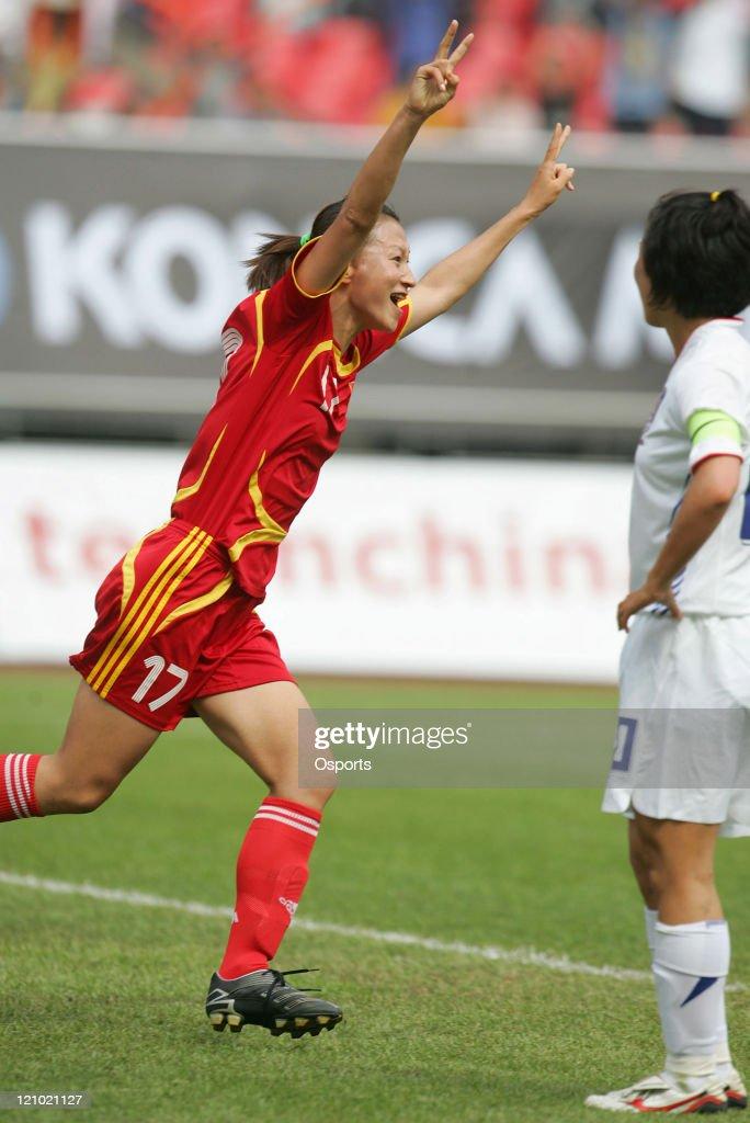 Jiang Shuai of China celebrates after scoring a goal during the friendship match between China national women's soccer team and Korea in Hangzhou on...