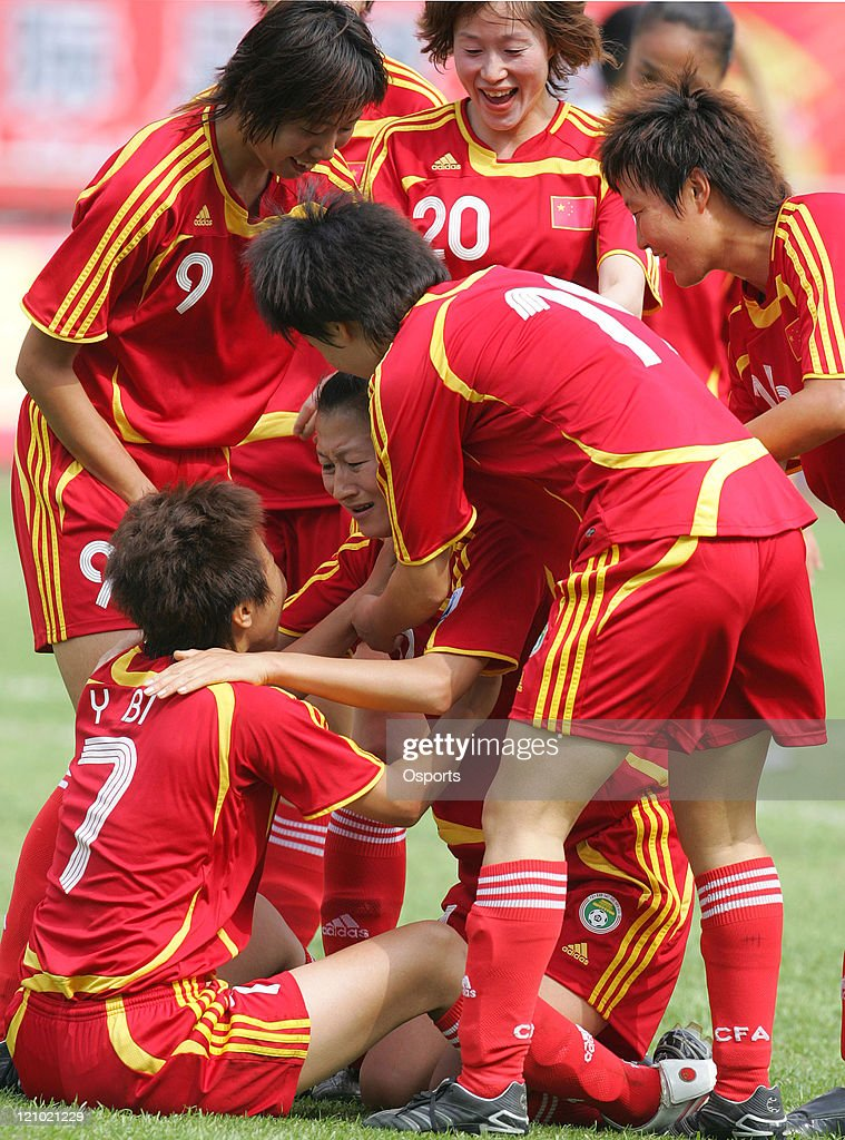 Jiang Shuai of China celebrates with teammates after scoring a goal during the friendship match between China national women's soccer team and Korea...