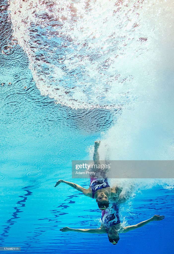Jiang Tingting and Jiang Wenwen of China compete during the Synchronized Swimming Duet Free Final on day six of the 15th FINA World Championships at Palau Sant Jordi on July 25, 2013 in Barcelona, Spain.