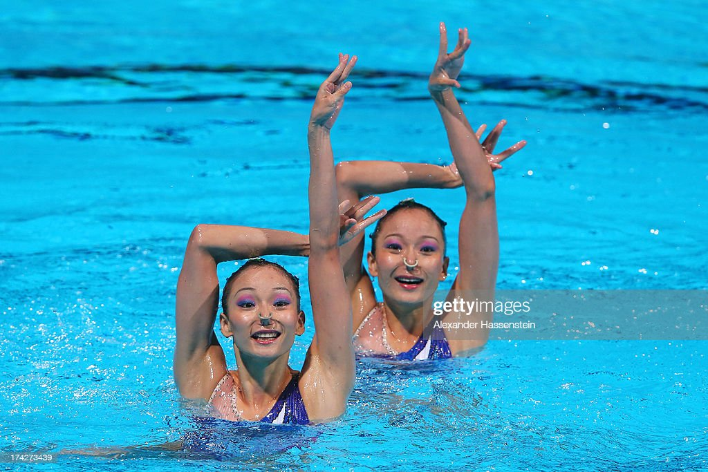 Jiang Tingting and Jiang Wenwen of China compete in the Synchronized Swimming Duet preliminary round on day four of the 15th FINA World Championships at Palau Sant Jordi on July 23, 2013 in Barcelona, Spain.