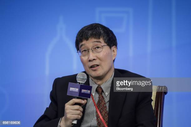 Jiang Wang Mizuho Financial Group professor at the MIT Sloan School of Management and research associate of the National Bureau of Economic Research...