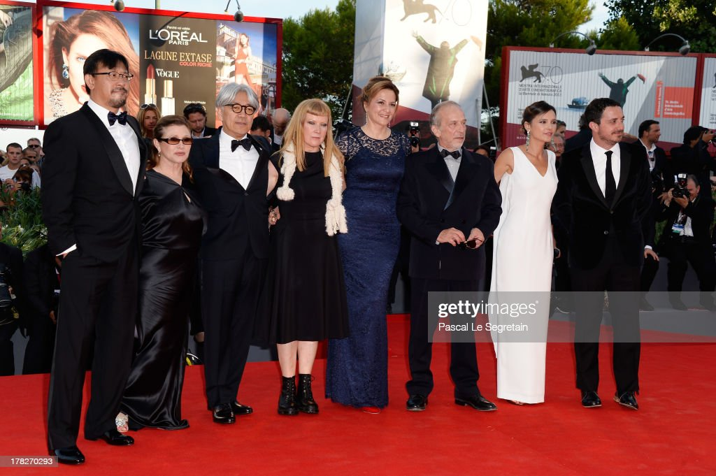 Jiang Wen, Carrie Fisher, Ryuichi Sakamoto, Andrea Arnold, Martina Gedek, Renato Berta, Virginie Ledoyen and Pablo Larrain attend the Opening Ceremony And 'Gravity' Premiere during the 70th Venice International Film Festival at the Palazzo del Cinema on August 28, 2013 in Venice, Italy.