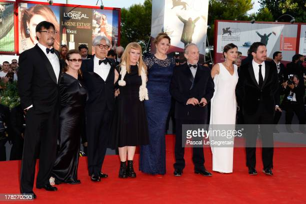 Jiang Wen Carrie Fisher Ryuichi Sakamoto Andrea Arnold Martina Gedek Renato Berta Virginie Ledoyen and Pablo Larrain attend the Opening Ceremony And...