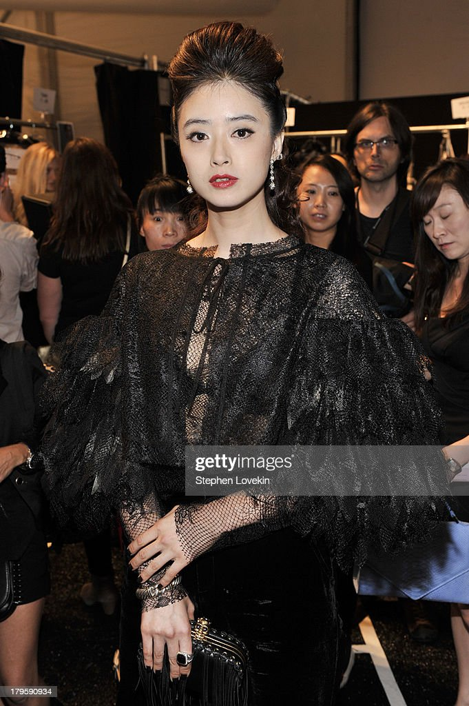 Jiang Xin prepares backstage at the Tadashi Shoji Spring 2014 fashion show during Mercedes-Benz Fashion Week at The Stage at Lincoln Center on September 5, 2013 in New York City.