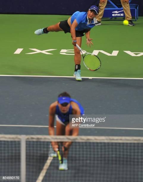 Jiang Xinyu and Tang Qianhui of China play during the doubles final at the Jiangxi Open WTA tennis tournament in Nanchang in central China's Jiangxi...