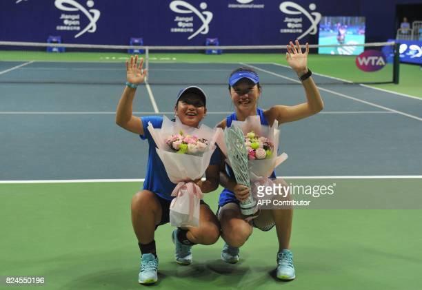 Jiang Xinyu and Tang Qianhui of China pose with the trophy after winning the doubles final at the Jiangxi Open WTA tennis tournament in Nanchang in...