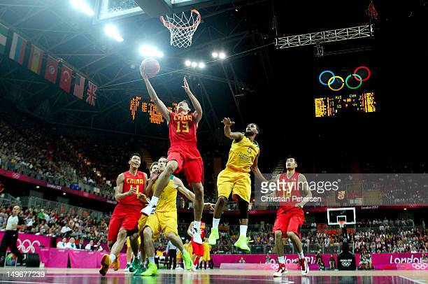 Jianghua Chen of China shoots against Patrick Mills of Australia in the second half during the Men's Basketball Preliminary Round match on Day 6 of...