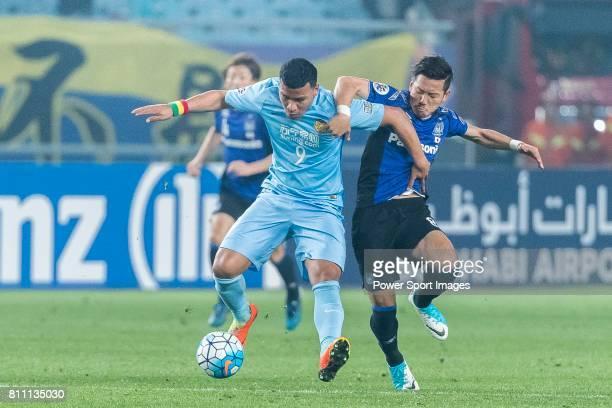 Jiangsu FC Forward Roger Beyker Martinez fights for the ball with Gamba Osaka Midfielder Ideguchi Yosuke during the AFC Champions League 2017 Group H...