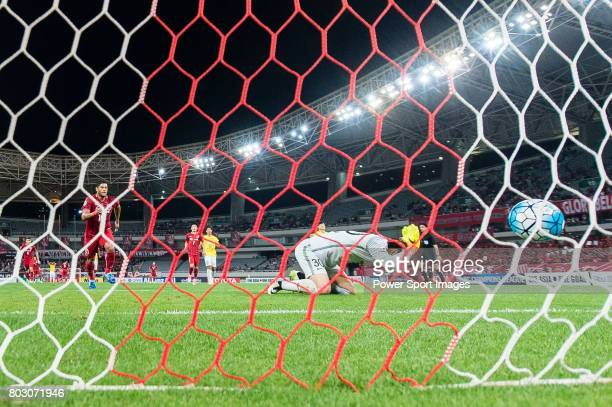 Jiangsu FC Goalkeeper Zhang Sipeng reacts after Shanghai FC Forward Givanildo Vieira De Sousa who scores a penalty during the AFC Champions League...
