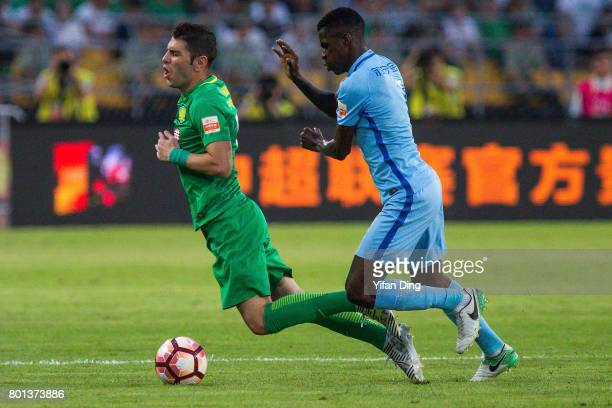 Jiangsu FC player Ramires Santos and Beijing Guoan player Jonathan Soriano compete for the ball during the China Super League match between Beijing...