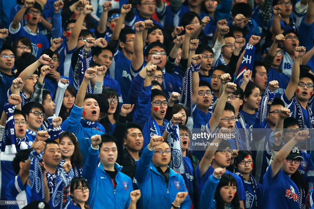 Jiangsu Sainty fans show their support during the AFC Champions League match between Jiangsu Sainty and Vegalta Sendai at Nanjing Olympic Sports Center Stadium on March 12, 2013 in Nanjing, China.
