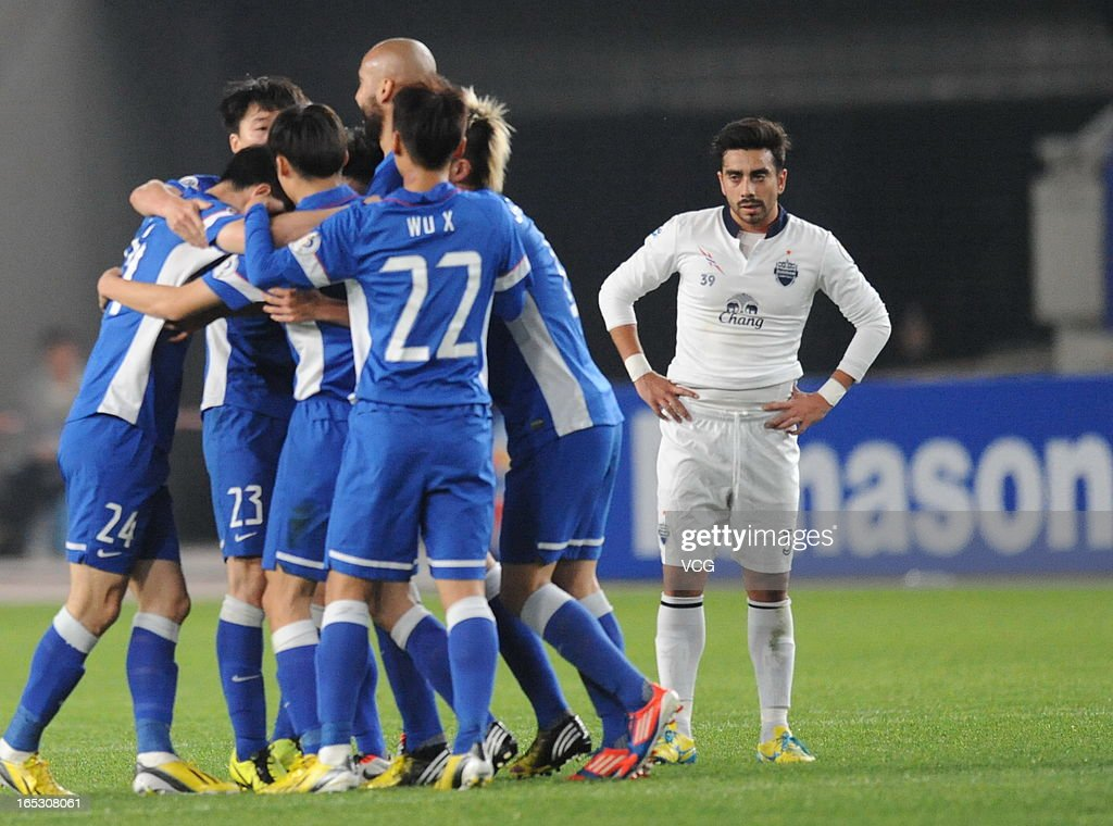 Jiangsu Sainty players celebrate their team's first goal during the AFC Champions League match between Jiangsu Sainty and Buriram United at Nanjing Olympic Sports Center Stadium on April 2, 2013 in Nanjing, China.