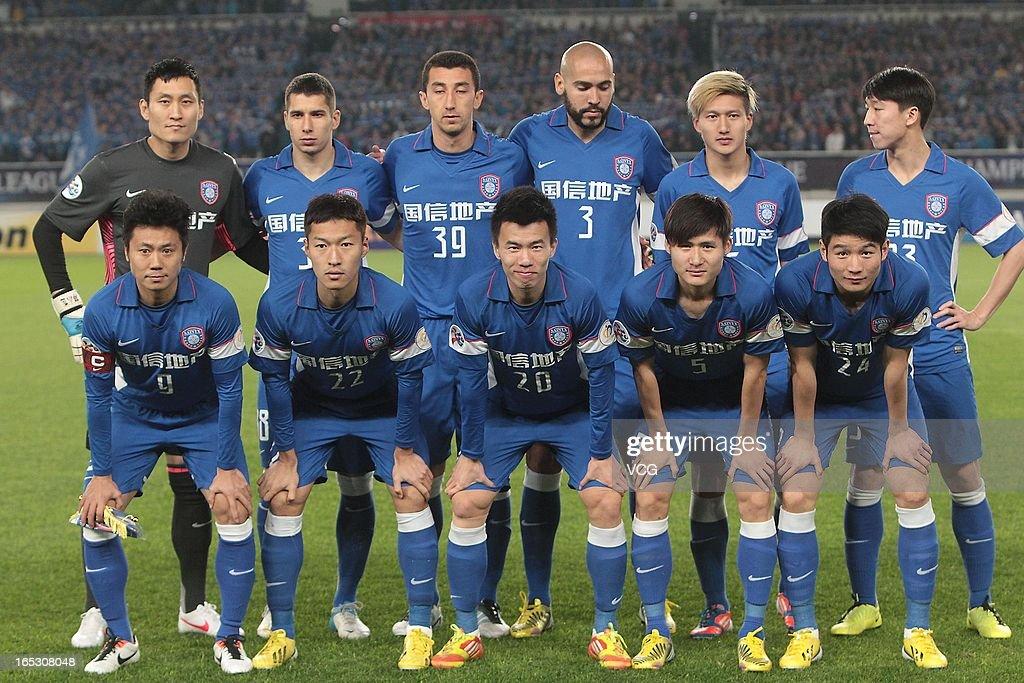 Jiangsu Sainty players line up prior to the AFC Champions League match between Jiangsu Sainty and Buriram United at Nanjing Olympic Sports Center Stadium on April 2, 2013 in Nanjing, China.