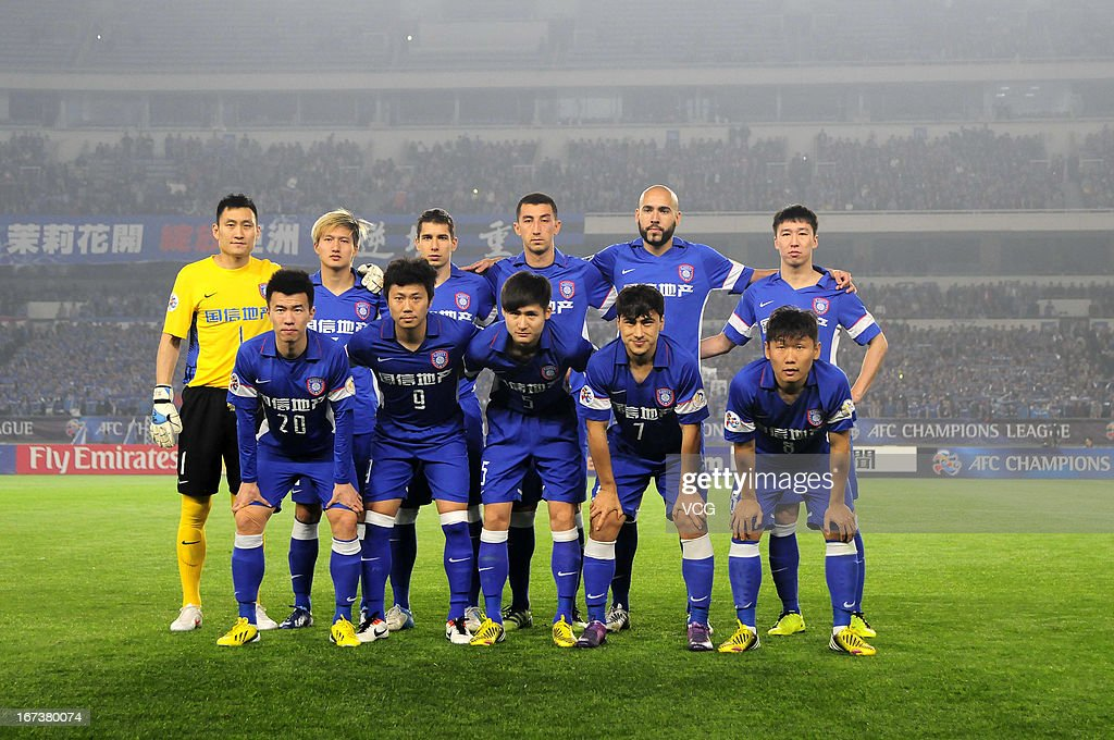 Jiangsu Sainty players line up prior to the AFC Champions League match between Jiangsu Sainty and FC Seoul at Nanjing Olympic Sports Center Stadium on April 24, 2013 in Nanjing, China.