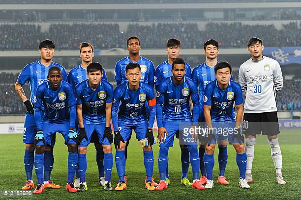 Jiangsu Suning players line up prior to the AFC Champions League Group E match between Jiangsu Suning and Jeonbuk Hyundai Motors at Olympic Sports...