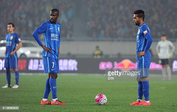 Jiangsu Suning's Ramires and Jiangsu Suning's Alex Teixeira wait during the Chinese Super League football between Jiangsu Suning and Shandong Luneng...