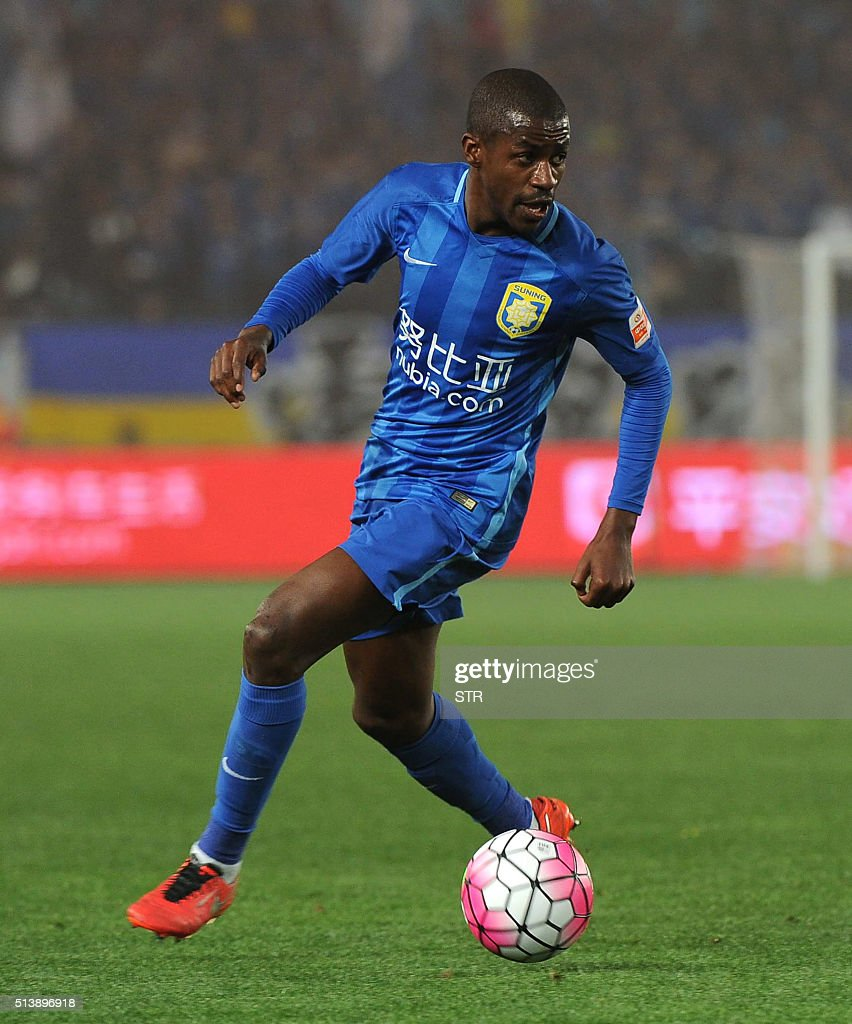 Jiangsu Suning s Ramires controls the ball during the Chinese