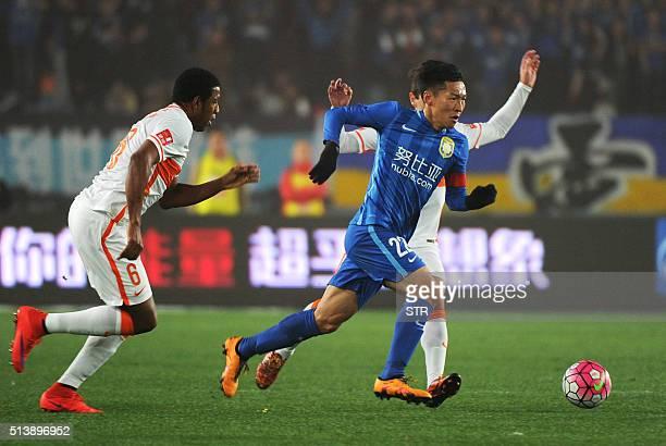 Jiangsu Suning's Wu Xi runs for the ball during the Chinese Super League football between Jiangsu Suning and Shandong Luneng on March 5 2016 in...