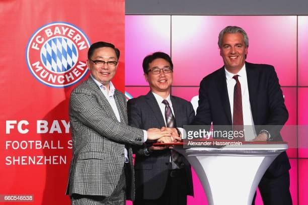Jianguang Wang Chairman of China Sports Futurity Investment Yongjian Wang President Shenzen Investment Holdings and Joerg Wacker Board member of FC...