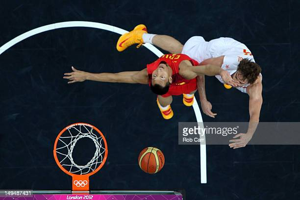 Jianlian Yi of China and Pau Gasol of Spain go for a rebound during their Men's Basketball Game on Day 2 of the London 2012 Olympic Games at the...
