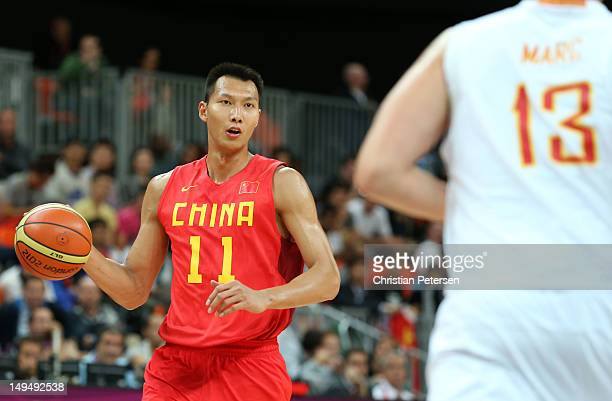 Jianlian Yi of China dribbles the ball against Spain during their Men's Basketball Game on Day 2 of the London 2012 Olympic Games at the Basketball...