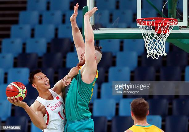 Jianlian Yi of China drives to the basket against Aron Baynes of Australia during the Men's Basketball Preliminary Round Group A China vs Australia...