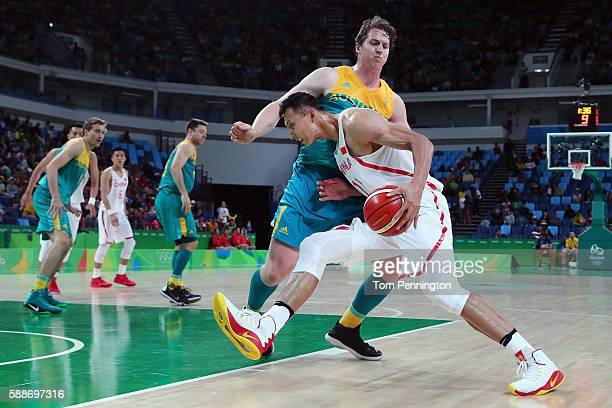 Jianlian Yi of China drives to the basket against Cameron Bairstow of Australia during the Men's Basketball Preliminary Round Group A China vs...