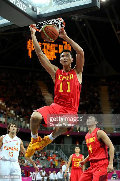 Jianlian Yi of China dunks against Spain during their Men's Basketball Game on Day 2 of the London 2012 Olympic Games at the Basketball Arena on July...