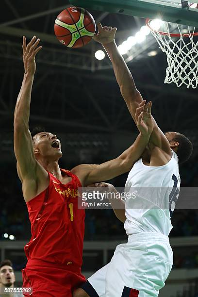 Jianlian Yi of China shoots the ball over Nando de Colo of France in the men's preliminary round group A game 19 on Day 3 of the Rio 2016 Olympic...