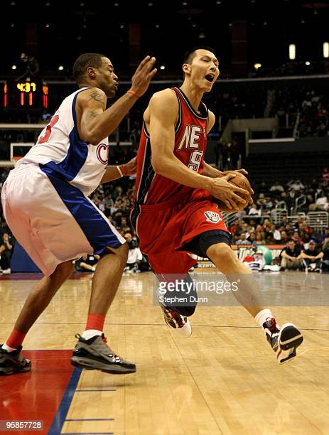 Jianlian Yiu of the New Jersey Nets drives against Marcus Camby of the Los Angeles Clippers on January 18 2010 at Staples Center in Los Angeles...