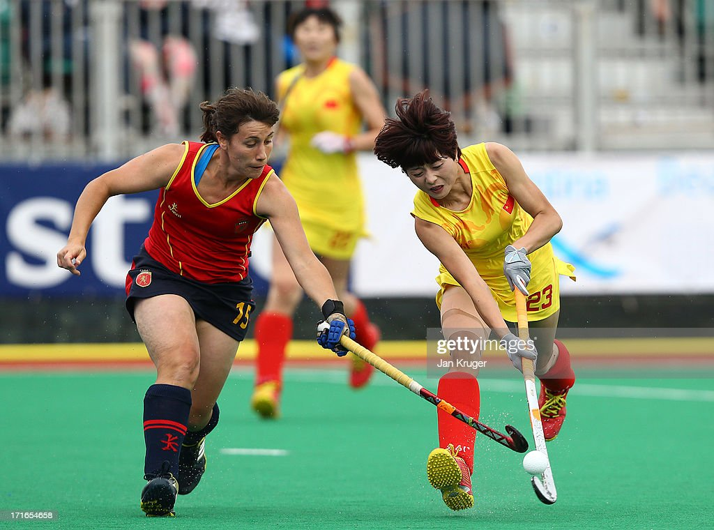 Jiaojiao De of China (R) battles with Anabel Flores Conde of Spain during the Investec Hockey World League quarterfinal match between China and Spain at the Quintin Hogg Memorial Sports Grounds on June 27, 2013 in London, England.