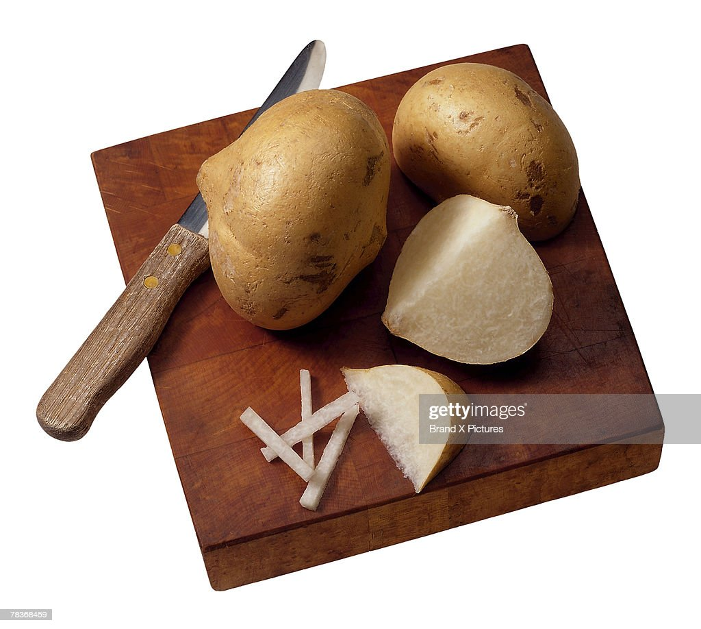Jicama on cutting board : Stock Photo