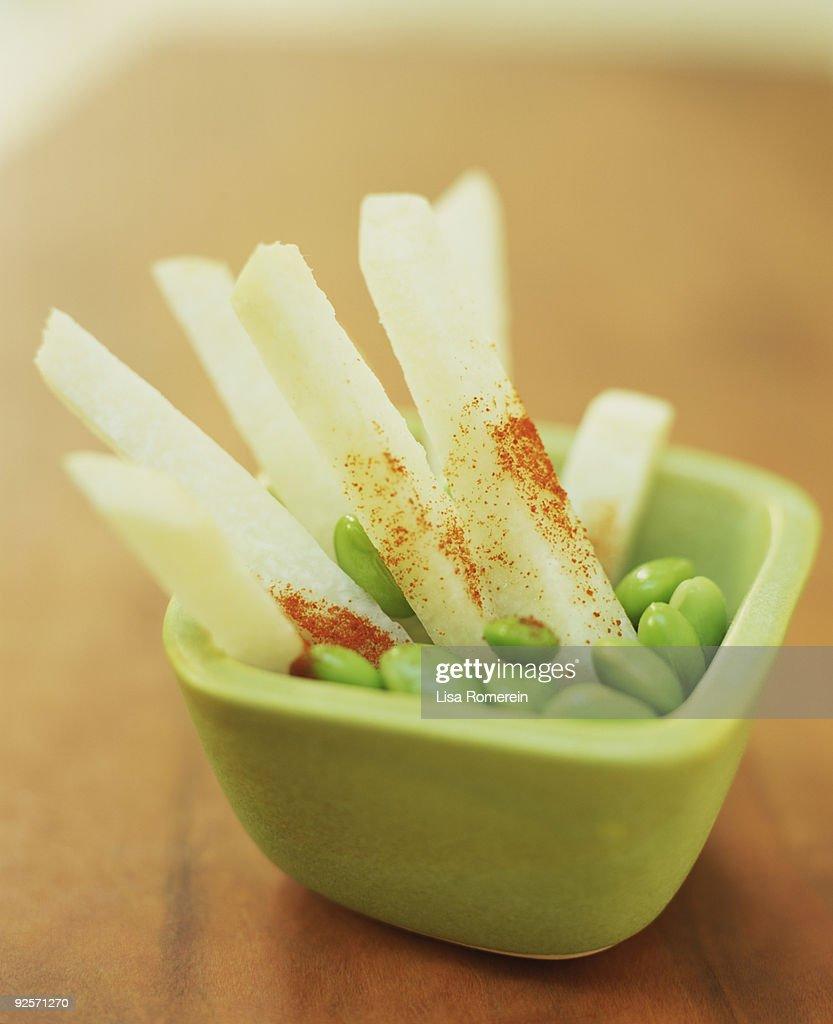Jicama with chile powder : Stock Photo