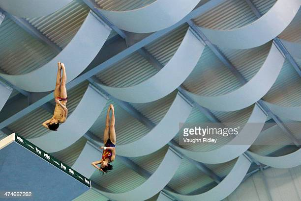 Jie Lian and Xiaohu Tai of China competes in the Mixed 10m Synchro Final during the FINA/NVC Diving World Series at the Windsor International Aquatic...