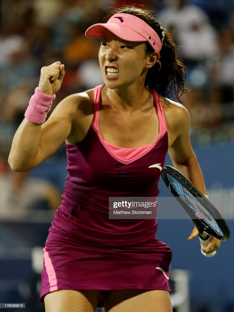 Jie Zheng of China celebrates a point against Venus Williams of the United States of America during their woman's singles second round match on Day Three of the 2013 US Open at USTA Billie Jean King National Tennis Center on August 28, 2013 in the Flushing neighborhood of the Queens borough of New York City.