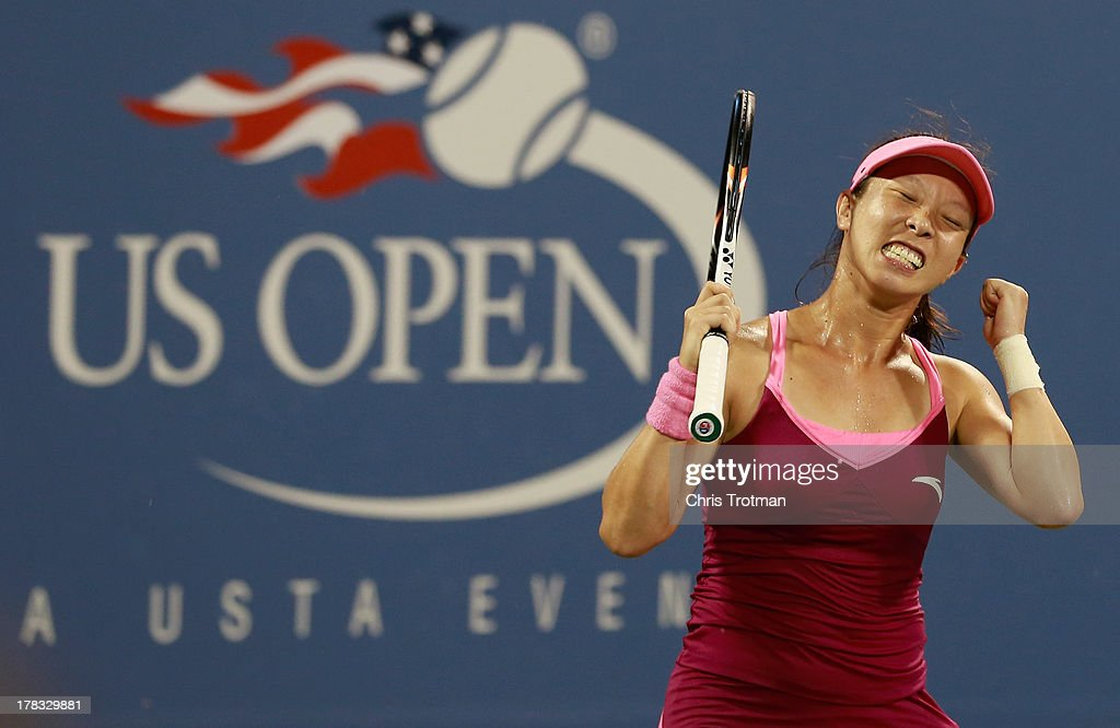Jie Zheng of China celebrates against Venus Williams of the United States on Day Three of the 2013 US Open at the USTA Billie Jean King National Tennis Center on August 28, 2013 in New York City.