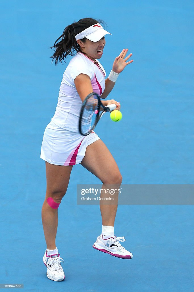 Jie Zheng of China plays a forehand in her third round match against Julia Goerges of Germany during day five of the 2013 Australian Open at Melbourne Park on January 18, 2013 in Melbourne, Australia.