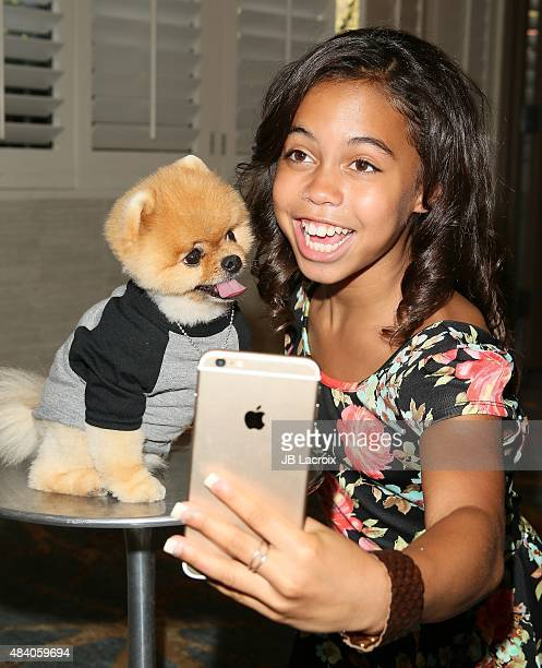 Jiff the Dog and Asia Monet Ray attend the KIIS FM's Annual Teen Choice preparty at the W Westwood on August 14 2015 in Westwood California