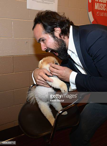 Jiff The Pomeranian and Ronnie Vannucci Jr of The Killers attend the 2015 iHeartRadio Music Festival at MGM Grand Garden Arena on September 18 2015...
