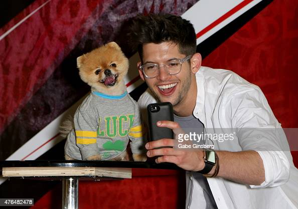 Jiff the world's fastest dog on two paws and actor Hunter March take a selfie as they attend the Licensing Expo 2015 at the Mandalay Bay Convention...