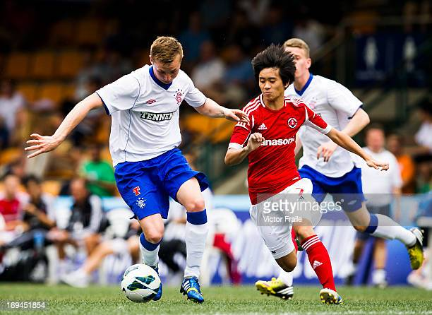 Jige Kuota Lai Hin of South China and Robbie Crawford of Rangers fight for the ball on day two of the Hong Kong International Soccer Sevens at Hong...